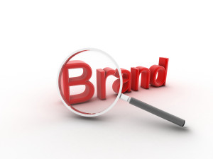 The word Brand under a magnifying glass illustrating marketing a